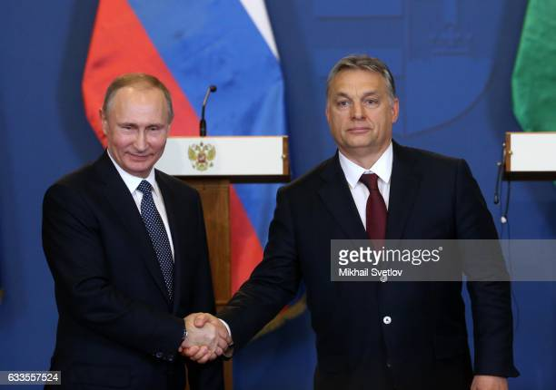 Russian President Vladimir Putin shakes hands with Hungarian Prime Minister Viktor Orban during their joint press conference February 2 2017 in...
