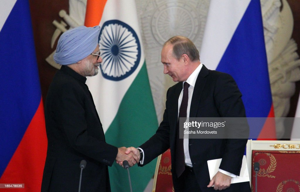 Russian President <a gi-track='captionPersonalityLinkClicked' href=/galleries/search?phrase=Vladimir+Putin&family=editorial&specificpeople=154896 ng-click='$event.stopPropagation()'>Vladimir Putin</a> (R) shakes hands with Indian Prime Minister <a gi-track='captionPersonalityLinkClicked' href=/galleries/search?phrase=Manmohan+Singh&family=editorial&specificpeople=227120 ng-click='$event.stopPropagation()'>Manmohan Singh</a> (L) during their bilateral meeting in the Kremlin on October 21, 2013 in Moscow, Russia, Prime Minister <a gi-track='captionPersonalityLinkClicked' href=/galleries/search?phrase=Manmohan+Singh&family=editorial&specificpeople=227120 ng-click='$event.stopPropagation()'>Manmohan Singh</a> is currently on a state visit to Russia.