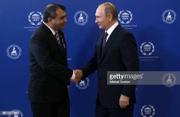 Russian President Vladimir Putin shakes hands with IPU President Saber Hossen Chowdhury on during the opening of 137th InterParliamentary Union...