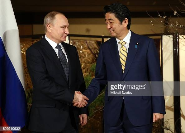 Russian President Vladimir Putin shakes hands with Japanese Prime Minister Shinzo Abe during the official reception ceremony on December 15 2016 in...