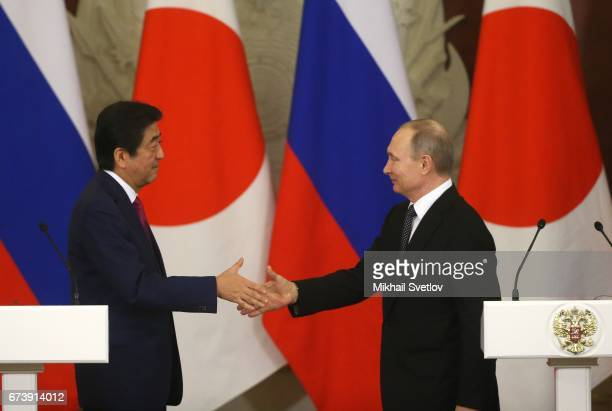 Russian President Vladimir Putin shakes hands with Japanese Prime Minister Shinzo Abe during their talks at the Grand Kremlin Palace on April 27 2017...