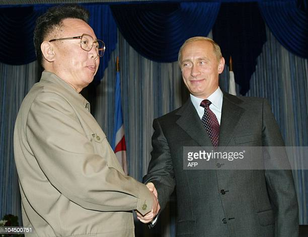 Russian President Vladimir Putin shakes hands with North Korean leader Kim Jong Il during their meeting in Vladivostok 23 August 2002 AFP PHOTO/...
