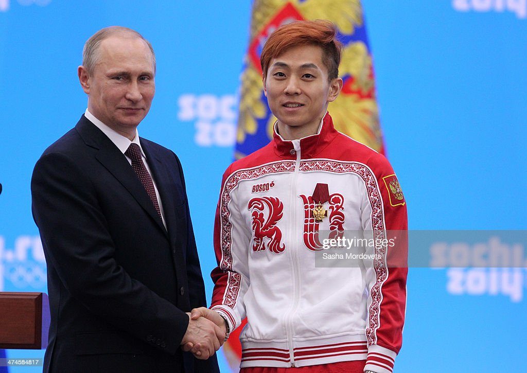 Russian President <a gi-track='captionPersonalityLinkClicked' href=/galleries/search?phrase=Vladimir+Putin&family=editorial&specificpeople=154896 ng-click='$event.stopPropagation()'>Vladimir Putin</a> shakes hands with Olympic gold medalist in speed skating Viktor Ahn (R) after presenting him with an award during an awards ceremony for Russian Olympic athletes on February 24, 2014 in Sochi, Russia. Russian President <a gi-track='captionPersonalityLinkClicked' href=/galleries/search?phrase=Vladimir+Putin&family=editorial&specificpeople=154896 ng-click='$event.stopPropagation()'>Vladimir Putin</a> presented awards to members of the Russian Olympic team a day after the closing ceremony of the 2014 Winter Olympics, in which Russia topped the medals table with 13 gold, 11 silver and 9 bronze medals.