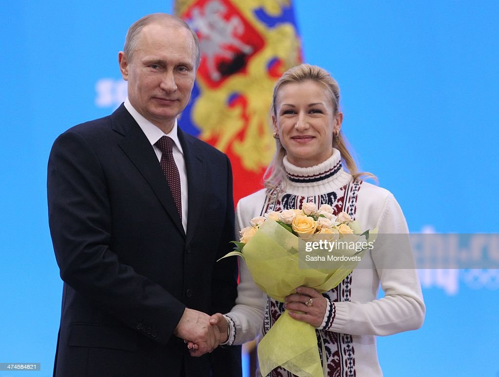 Russian President <a gi-track='captionPersonalityLinkClicked' href=/galleries/search?phrase=Vladimir+Putin&family=editorial&specificpeople=154896 ng-click='$event.stopPropagation()'>Vladimir Putin</a> shakes hands with Olympic gold medalist in figure skating Tatyana Volosozhar (R) after presenting him with an award during an awards ceremony for Russian Olympic athletes on February 24, 2014 in Sochi, Russia. Russian President <a gi-track='captionPersonalityLinkClicked' href=/galleries/search?phrase=Vladimir+Putin&family=editorial&specificpeople=154896 ng-click='$event.stopPropagation()'>Vladimir Putin</a> presented awards to members of the Russian Olympic team a day after the closing ceremony of the 2014 Winter Olympics, in which Russia topped the medals table with 13 gold, 11 silver and 9 bronze medals.