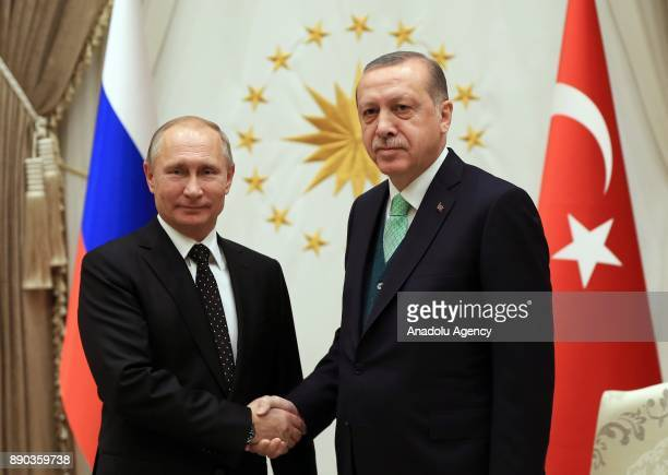 Russian President Vladimir Putin shakes hands with President of Turkey Recep Tayyip Erdogan following an official welcoming ceremony at Presidential...