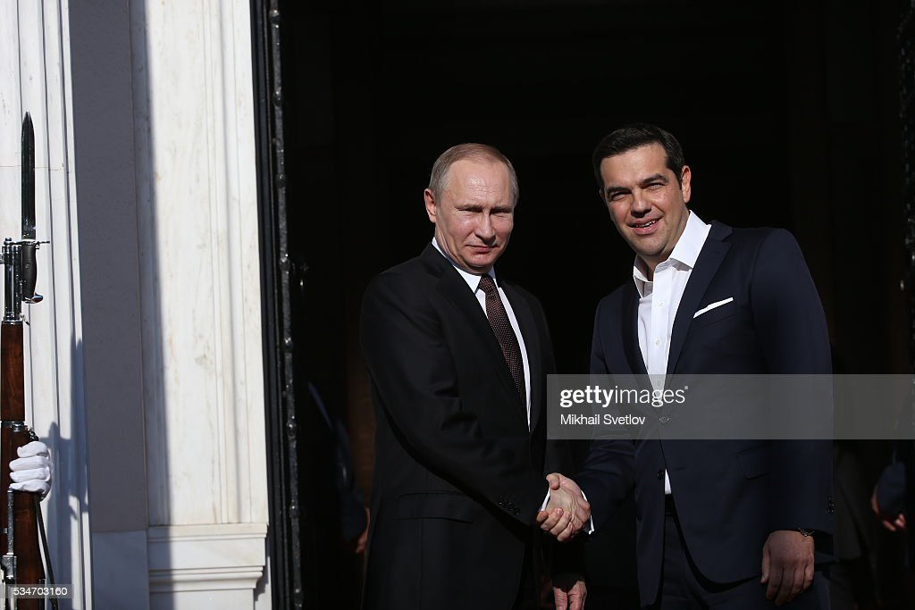 Russian President <a gi-track='captionPersonalityLinkClicked' href=/galleries/search?phrase=Vladimir+Putin&family=editorial&specificpeople=154896 ng-click='$event.stopPropagation()'>Vladimir Putin</a> (L) shakes hands with Prime Minister of Greece <a gi-track='captionPersonalityLinkClicked' href=/galleries/search?phrase=Alexis+Tsipras&family=editorial&specificpeople=6592450 ng-click='$event.stopPropagation()'>Alexis Tsipras</a> (R) during their meeting in Athens, Greece, May 27, 2016. <a gi-track='captionPersonalityLinkClicked' href=/galleries/search?phrase=Vladimir+Putin&family=editorial&specificpeople=154896 ng-click='$event.stopPropagation()'>Vladimir Putin</a> is having a state visit to Greece.