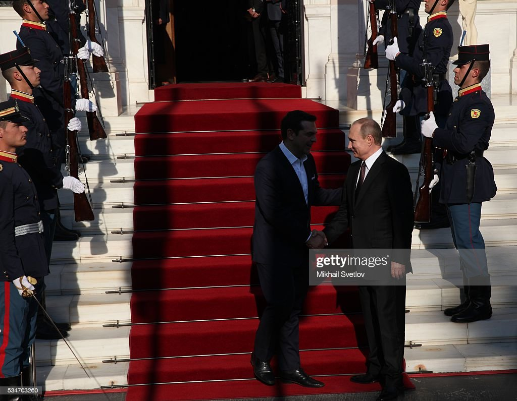 Russian President <a gi-track='captionPersonalityLinkClicked' href=/galleries/search?phrase=Vladimir+Putin&family=editorial&specificpeople=154896 ng-click='$event.stopPropagation()'>Vladimir Putin</a> (L) shakes hands with Prime Minister of Greece Alexis Tsipras (R) during their meeting in Athens, Greece, May 27, 2016. <a gi-track='captionPersonalityLinkClicked' href=/galleries/search?phrase=Vladimir+Putin&family=editorial&specificpeople=154896 ng-click='$event.stopPropagation()'>Vladimir Putin</a> is having a state visit to Greece.
