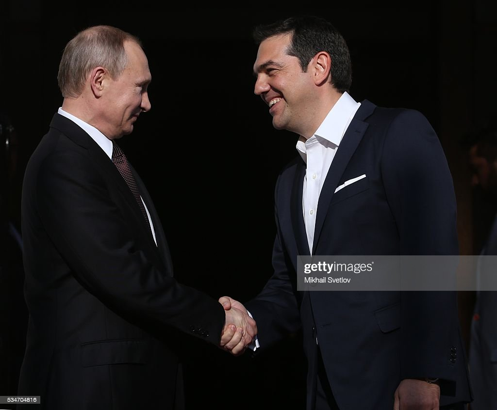 Russian President Vladimir Putin (L) shakes hands with Prime Minister of Greece Alexis Tsipras (R) during their meeting in Athens, Greece, May 27, 2016. Vladimir Putin is having a state visit to Greece.