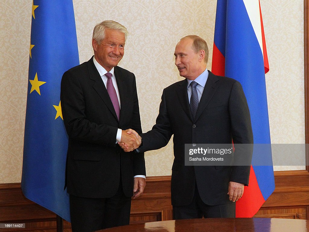 Russian President <a gi-track='captionPersonalityLinkClicked' href=/galleries/search?phrase=Vladimir+Putin&family=editorial&specificpeople=154896 ng-click='$event.stopPropagation()'>Vladimir Putin</a> (R) shakes hands with Secretary General of the Council of Europe <a gi-track='captionPersonalityLinkClicked' href=/galleries/search?phrase=Thorbjorn+Jagland&family=editorial&specificpeople=862853 ng-click='$event.stopPropagation()'>Thorbjorn Jagland</a> during a meeting May 20, 2013 in Sochi, Russia. Jagland was in Russia to meet with Putin and Russian Foreign Minister Sergey Lavrov to discuss reforming the Council of Europe .