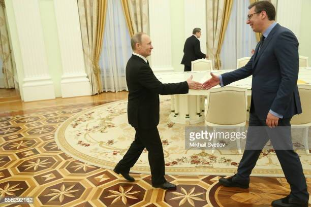 Russian President Vladimir Putin shakes hands with Serbian Prime Minister Aleksandar Vucic during their meeting at the Kremlin on March 27 2017 in...