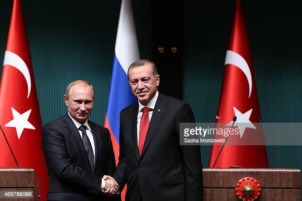 Russian President Vladimir Putin shakes hands with Turkish President Recep Tayyip Erdogan during a joint press conference with December 1 2014 in...