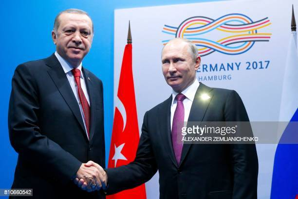 Russian President Vladimir Putin shakes hands with Turkish President Recep Tayyip Erdogan during their bilateral meeting at the G20 summit in Hamburg...