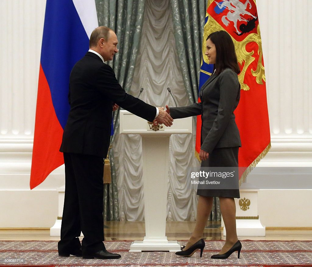 Russian President <a gi-track='captionPersonalityLinkClicked' href=/galleries/search?phrase=Vladimir+Putin&family=editorial&specificpeople=154896 ng-click='$event.stopPropagation()'>Vladimir Putin</a> (L) shakes hands with Yekaterina Proshkina, PhD in Biology, researcher at the Institute of Biology of the Komi Science Centre of the Russian Academy of Sciences' Ural Branch, during the ceremony to award prizes to young scientists for their contribution to Russian science and innovative activities in 2015, on February 10, 2016 in Moscow, Russia. Russian President Putin awarded 3 scientists during the reception at the Krelmlin.