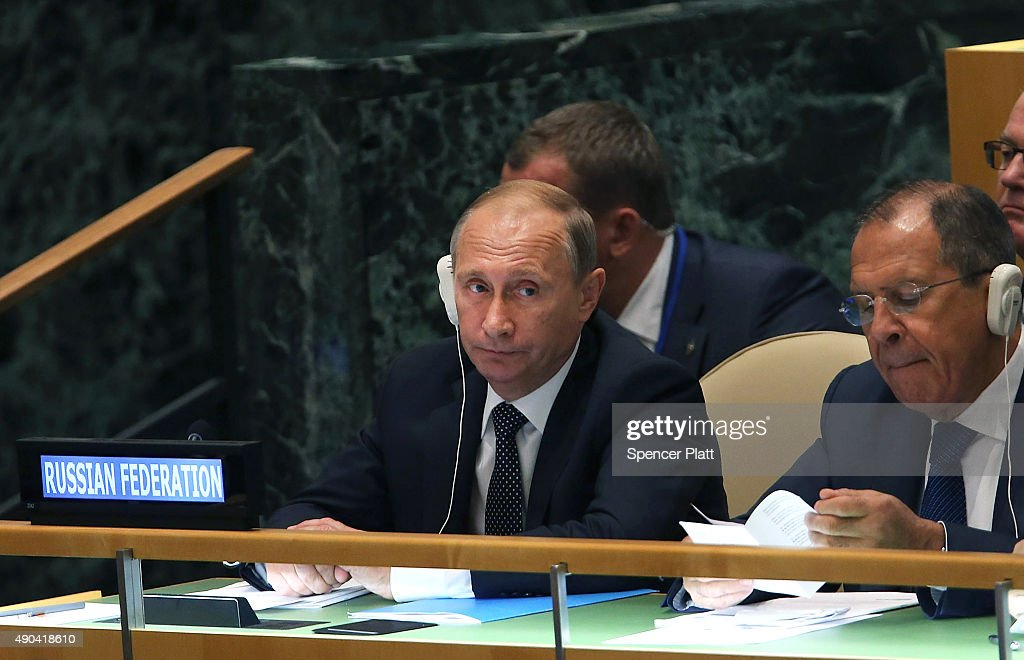 Russian President Vladimir Putin sits with the Russian Foreign Minister Sergey Lavrov (R) at the United Nations General Assembly at U.N. headquarters on September 28, 2015 in New York City. The ongoing war in Syria and the refugee crisis it has spawned are playing a backdrop to this years 70th annual General Assembly meeting of global leaders.