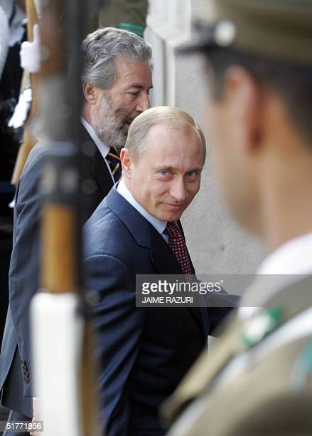 Russian President Vladimir Putin smiles as he enters at La Moneda Presidential Palace to attend for the opening of the APEC leaders' 2nd retreat AFP...