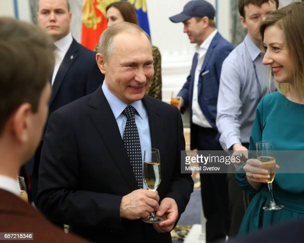 Russian President Vladimir Putin smiles as he speaks to guests during the awards ceremony at the Kremlim on March 2017 in Moscow Russia has awarded 6...