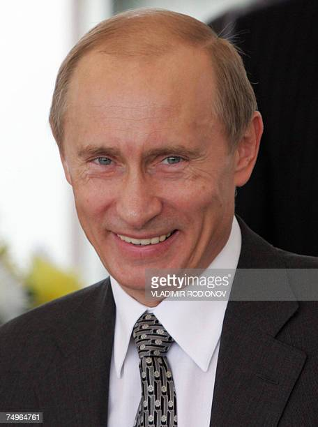 Russian President Vladimir Putin smiles as he watches a horse races at the President's Cup tournament in RostovonDon 30 June 2007 Venezuelan...