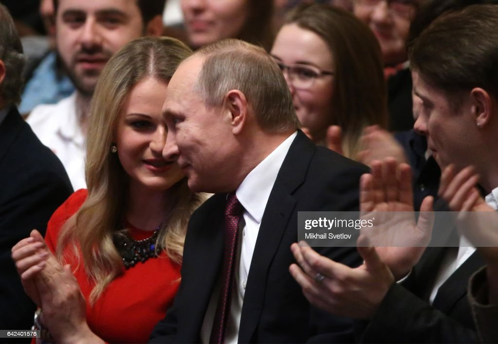 Russian President Vladimir Putin (C) smiles as opera singer Dara Savinova (L) looks on while visiting the premiere of theatre performance called 'Do not leave our planned' during the openings of 10-th Winter International Arts Festival February 17, 2017 in Moscow, Russia.