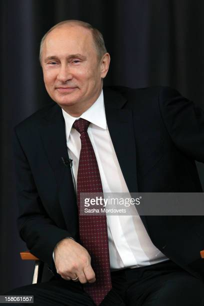 Russian President Vladimir Putin smiles duriing a meeting with supporters of his presidential campaign on December 10 2012 in Moscow Russia Over 500...