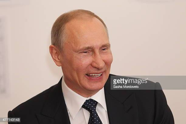 Russian President Vladimir Putin smiles during a meeting with Russian Paralympic team is the Olympic villiage on March 7 2014 in Sochi Russia
