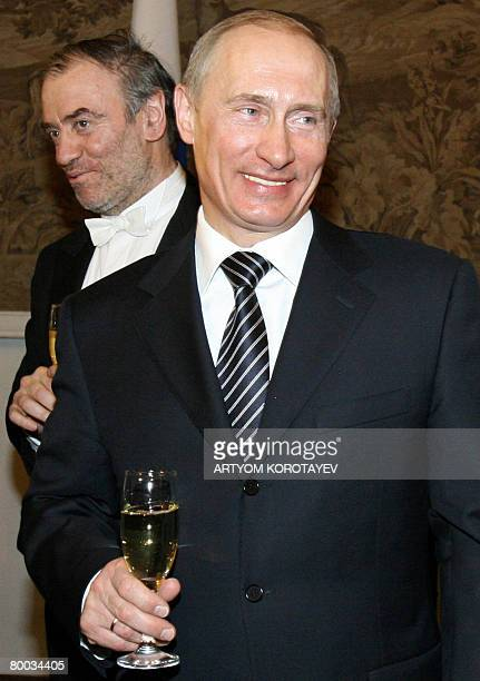 Russian President Vladimir Putin smiles during the celebration of the 225 anniversary of famous Mariinsky Theater in St Peterburg on February 27 with...