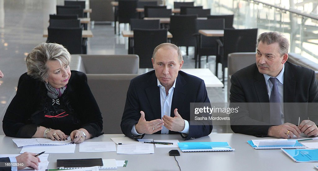 Russian President Vladimir Putin (C) speaks as Figure Scating coach Tatiana Tarasova (L) and former goaltender for the Soviet Union's national ice hockey team Vladislav Tretiak (R) attend a meeting at the Bolshoy Ice Dome, an ice hockey arena in the Sochi Olympic Park on March, 2013 in Russia. Sochi will host the 2014 Winter Olympics.