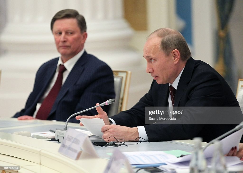 Russian President Vladimir Putin (R) speaks as Head of the Presidential Administration Sergey Ivanov looks on during a meeting with G20 finance leaders in the Kremlin February 15, 2013 in Moscow, Russia. The G20 countries, that make up 90 percent of the worlds gross domestic product, is reportedly set to be dominated by the issue of counties using their currency fro economic gain over the weekend of meetings.