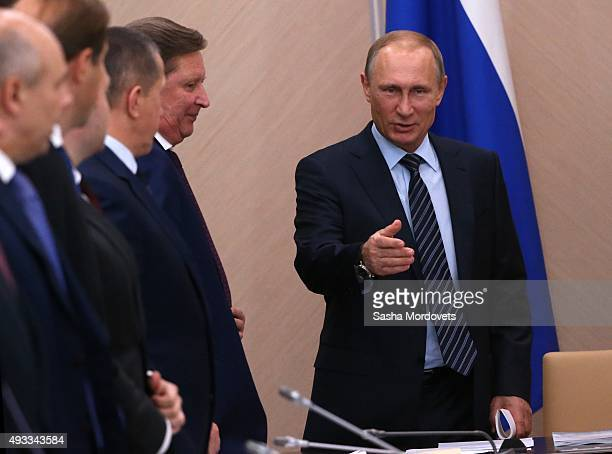 Russian President Vladimir Putin speaks as his Chief of Staff Sergei Ivanov looks on during the State Concil Presidium meeting on fish industry...
