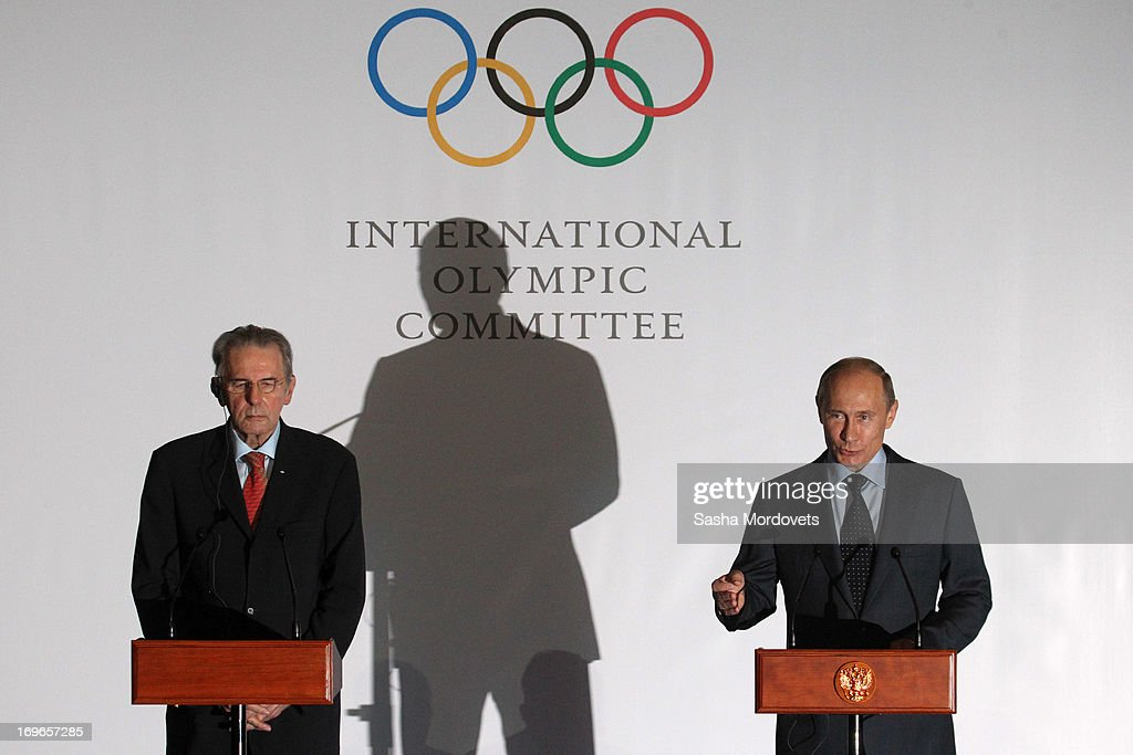 Russian President <a gi-track='captionPersonalityLinkClicked' href=/galleries/search?phrase=Vladimir+Putin&family=editorial&specificpeople=154896 ng-click='$event.stopPropagation()'>Vladimir Putin</a> (R) speaks as International Olympic Committee (IOC) President <a gi-track='captionPersonalityLinkClicked' href=/galleries/search?phrase=Jacques+Rogge&family=editorial&specificpeople=206143 ng-click='$event.stopPropagation()'>Jacques Rogge</a> listens during a presentation of the medals that will be awarded at the 2014 Winter Olympics in Sochi May 30, 2013 in Saint Petersburg, Russia. Putin also voiced his support for the inclusion in the Olympics of wrestling, which the IOC removed for the 2020 games.
