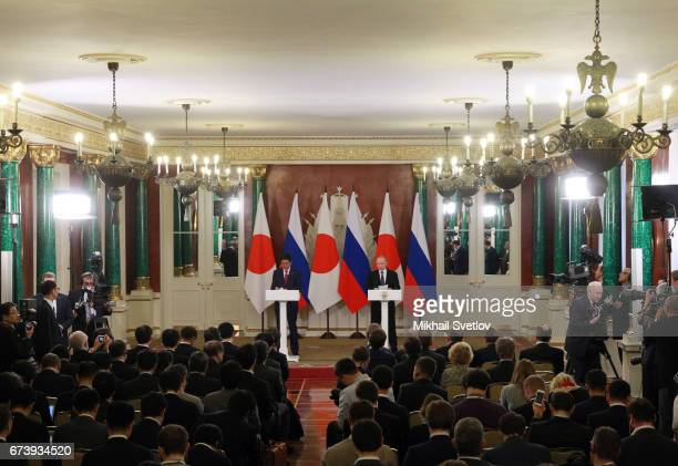 Russian President Vladimir Putin speaks as Japanese Prime Minister Shinzo Abe looks on during their press conference at the Grand Kremlin Palace on...