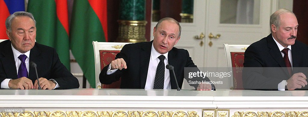 Russian President <a gi-track='captionPersonalityLinkClicked' href=/galleries/search?phrase=Vladimir+Putin&family=editorial&specificpeople=154896 ng-click='$event.stopPropagation()'>Vladimir Putin</a> (C), speaks as Kazakh President <a gi-track='captionPersonalityLinkClicked' href=/galleries/search?phrase=Nursultan+Nazarbayev&family=editorial&specificpeople=4556028 ng-click='$event.stopPropagation()'>Nursultan Nazarbayev</a> (L) and Belarus President <a gi-track='captionPersonalityLinkClicked' href=/galleries/search?phrase=Alexander+Lukashenko&family=editorial&specificpeople=542572 ng-click='$event.stopPropagation()'>Alexander Lukashenko</a> look on at the Summit of Collective Security Treaty Organisation (CSTO) on December 19, 2012 in Moscow, Russia. Leaders of Russia, Belarus, Kazakhstan, Kyrgyzstan and Armenia have gathered at the Kremlin in Moscow for the summit.