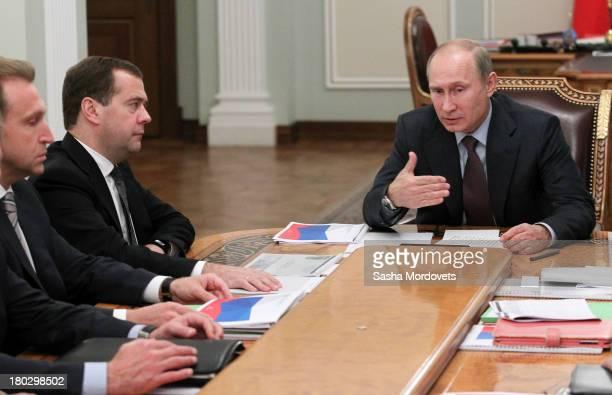 Russian President Vladimir Putin speaks as Prime Minister Dmitry Medvedev and First Deputy Prime Minsiter Igor Shuvalov listen during a meeting with...