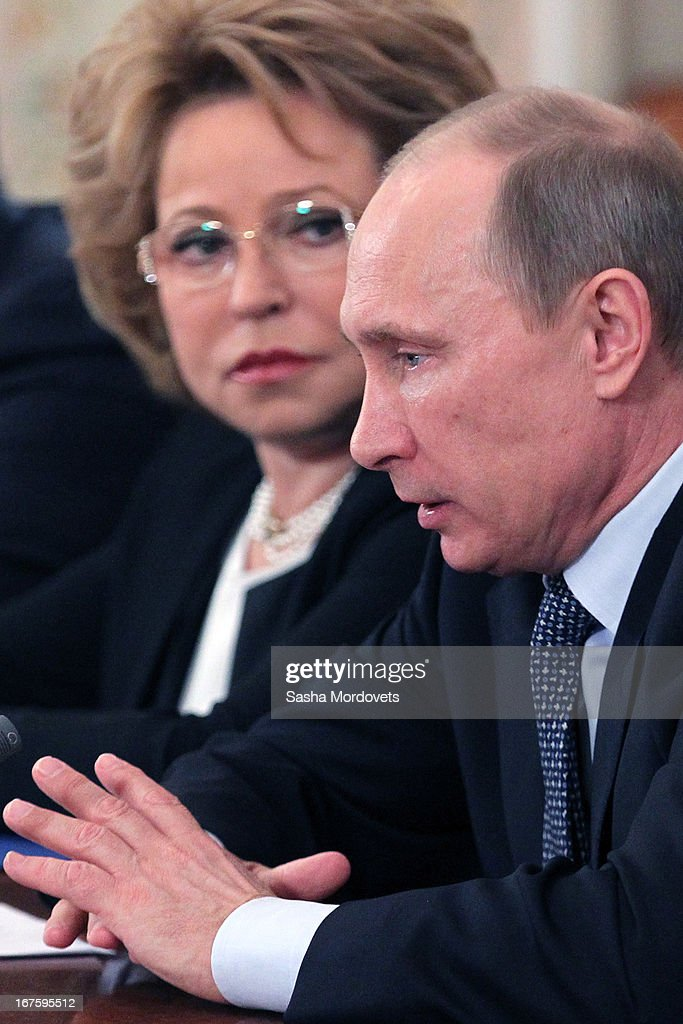 Russian President <a gi-track='captionPersonalityLinkClicked' href=/galleries/search?phrase=Vladimir+Putin&family=editorial&specificpeople=154896 ng-click='$event.stopPropagation()'>Vladimir Putin</a> (R) speaks as Speaker of the Federation Council Valentina Matviyenko looks on during a meeting at a state residence April 26, 2013 outside Moscow, Russia. Putin held a moment of silence for 38 people killed in a fire at a psychiatric hospital in the village of Ramensky north of Moscow early today.