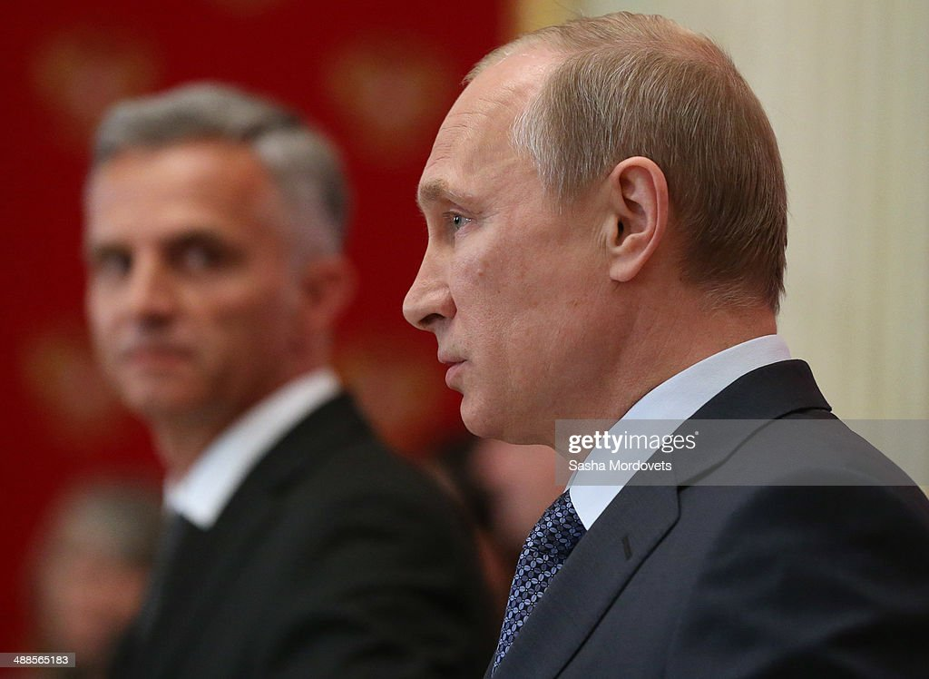Russian President <a gi-track='captionPersonalityLinkClicked' href=/galleries/search?phrase=Vladimir+Putin&family=editorial&specificpeople=154896 ng-click='$event.stopPropagation()'>Vladimir Putin</a> (R) speaks at a press conference with OSCE Chairman-in-office Didier Burkhaler (L) on May 7, 2014 in the Kremlin, Moscow, Russia. Burkahler is on a one-day visit to Moscow to discuss the situation in Ukraine.