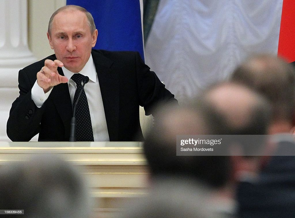 Russian President <a gi-track='captionPersonalityLinkClicked' href=/galleries/search?phrase=Vladimir+Putin&family=editorial&specificpeople=154896 ng-click='$event.stopPropagation()'>Vladimir Putin</a> speaks at the Council of Legislators of the country's Federal Assembly in the Kremlin December 13, 2012 in Moscow, Russia. Putin has described as 'unfriendly' a U.S. bill that imposes sanctions on Russian officials accused of human rights violations.