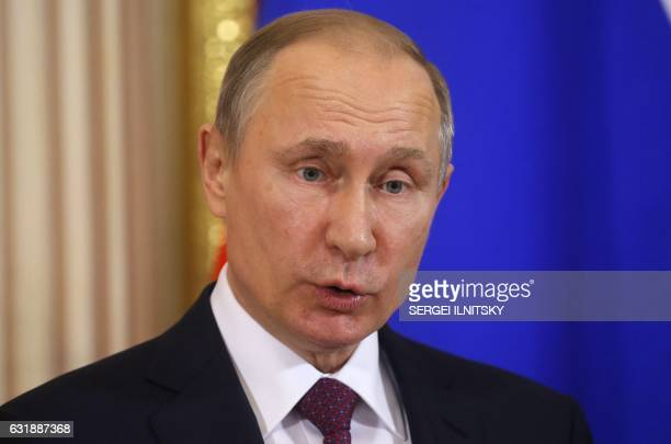 Russian President Vladimir Putin speaks during a joint press conference with his Moldovan counterpart following their meeting at the Kremlin in...