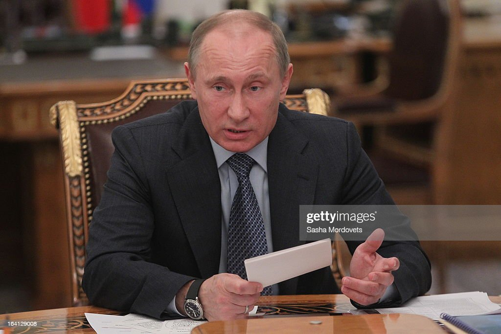 Russian President <a gi-track='captionPersonalityLinkClicked' href=/galleries/search?phrase=Vladimir+Putin&family=editorial&specificpeople=154896 ng-click='$event.stopPropagation()'>Vladimir Putin</a> speaks during a meeting with ministers and delegates from energy companies on March 20, 2013 in Moscow, Russia. Putin is due to meet China's new leader Xi Jinping later this week and 'key issues of bilateral cooperation' including energy, investments and the ongoing conflict in Syria are on the agenda for discussion.