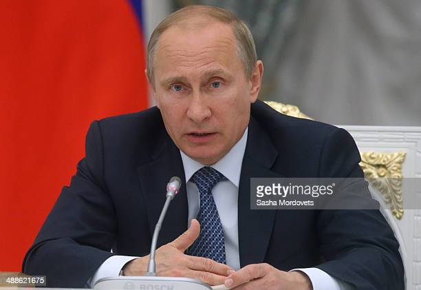 Russian President Vladimir Putin speaks during a meeting with ministers at the Kremlin on April 07 2014 in Moscow Russia Putin held a meeting of the...