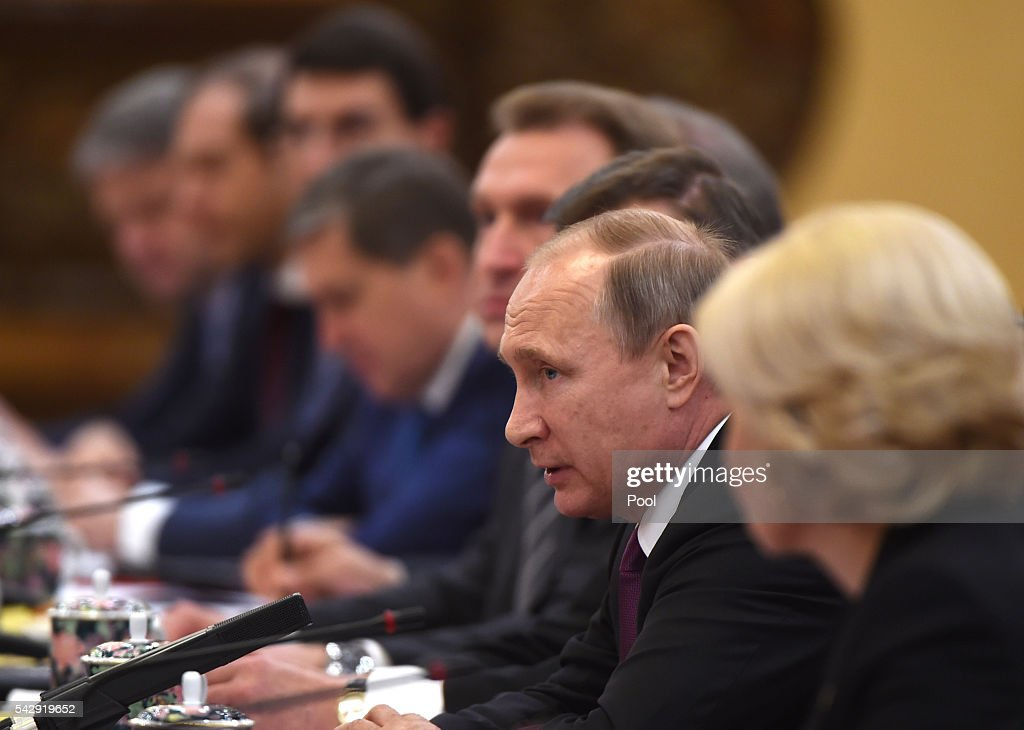 Russian President Vladimir Putin speaks during a meeting with Chinese President Xi Jinping in Beijing's Great Hall of the People on on June 25, 2016 in Beijing, China. Russian President Vladimir Putin is in China to discuss more economic and military cooperation between the two countries.
