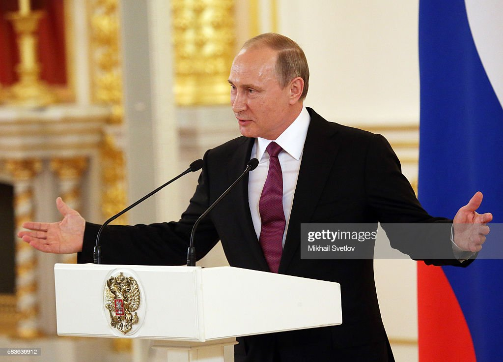 Russian President Vladimir Putin speaks during a meeting with the Russian national Olympic team including those prohibited to participate Rio 2016...