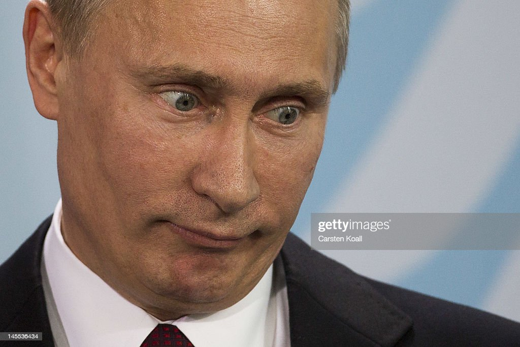 Russian President <a gi-track='captionPersonalityLinkClicked' href=/galleries/search?phrase=Vladimir+Putin&family=editorial&specificpeople=154896 ng-click='$event.stopPropagation()'>Vladimir Putin</a> speaks during a press conference with German Chancellor Angela Merkel at the Chancellery on June 1, 2012 in Berlin, Germany. Putin is on a one-day state visit to Germany before heading to France. The two leaders were reportedly expected to talk about Syria.