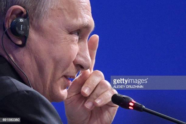Russian President Vladimir Putin speaks during a session of the St Petersburg International Economic Forum in Saint Petersburg on June 2 2017 / AFP...