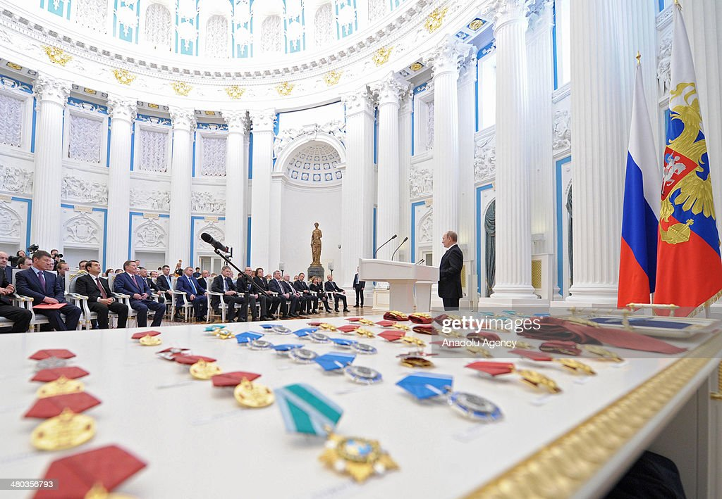 Russian President Vladimir Putin speaks during a state award ceremony for the participants of the Olympic and Paralympics Games in Sochi in the Kremlin,Moscow on March 24, 2014.