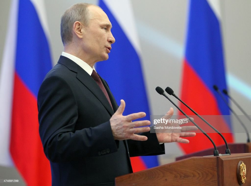 Russian President <a gi-track='captionPersonalityLinkClicked' href=/galleries/search?phrase=Vladimir+Putin&family=editorial&specificpeople=154896 ng-click='$event.stopPropagation()'>Vladimir Putin</a> speaks during an awards ceremony for Russian Olympic athletes on February 24, 2014 in Sochi, Russia. Russian President <a gi-track='captionPersonalityLinkClicked' href=/galleries/search?phrase=Vladimir+Putin&family=editorial&specificpeople=154896 ng-click='$event.stopPropagation()'>Vladimir Putin</a> presented awards to members of the Russian Olympic team a day after the closing ceremony of the 2014 Winter Olympics, in which Russia topped the medals table with 13 gold, 11 silver and 9 bronze medals.