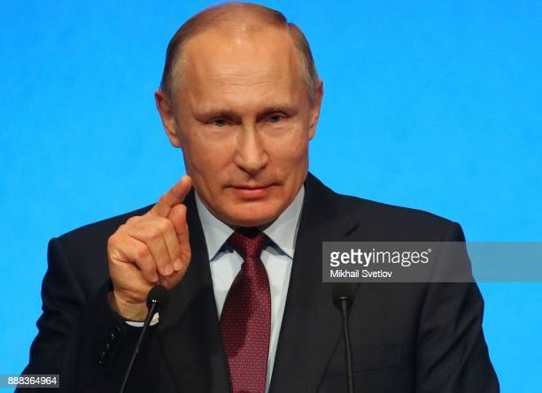 Russian President Vladimir Putin speaks during an event celebrating the first cargo shipment arriving at the new LNG plant in Sabetta sea port at...