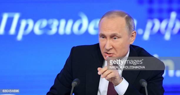 Russian President Vladimir Putin speaks during his annual press conference in Moscow on December 23 2016 / AFP / Natalia KOLESNIKOVA