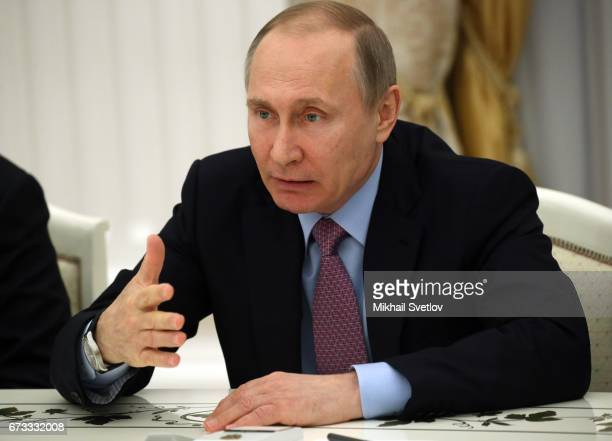 Russian President Vladimir Putin speaks during his meeting with Director of the General Office of the Communist Party of China and Chief of the...