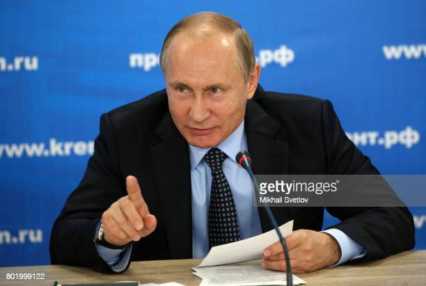 Russian President Vladimir Putin speaks during his meeting with military machine manufacturers and Defence Ministry officials at Kalashnikov Concern...
