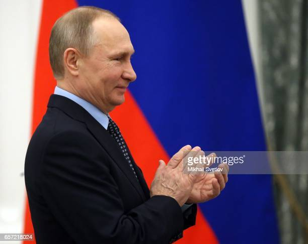 Russian President Vladimir Putin speaks during the awards ceremony at the Kremlim on March 2017 in Moscow Russia has awarded 6 people including 6...