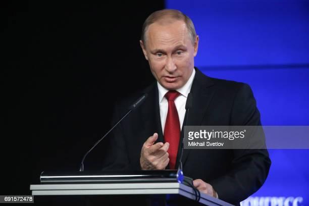 Russian President Vladimir Putin speaks during the Round table RussiaUSA at the Saint Petersburg International Economic Forum SPIEF' 2017 on June 2...
